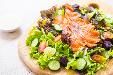 Raw Smoked salmon meat fish with fresh green vegetable salad and sauce - Healthy food concept Imagens - 115468556