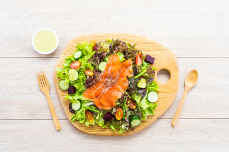 Raw Smoked salmon meat fish with fresh green vegetable salad and sauce - Healthy food concept Imagens - 115468559