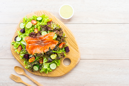 Raw Smoked salmon meat fish with fresh green vegetable salad and sauce - Healthy food concept Imagens - 115468473