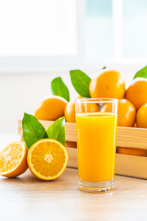 Fresh orange juice for drink in glass on wooden table - Healthy food concept Reklamní fotografie