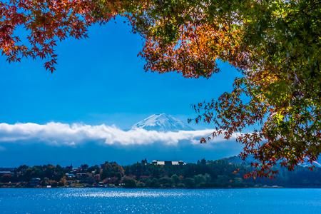 Beautiful landscape of mountain fuji with maple leaf tree around lake in autumn season
