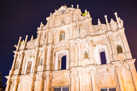 Beautiful old architecture building with ruin of st pual church landmark of macau city at twilight night time Imagens