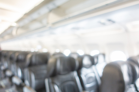 Abstract blur and defocused seat in airplane interior Imagens
