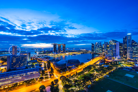 Beautiful architecture building exterior of singapore city skyline at twilight and night time Editorial