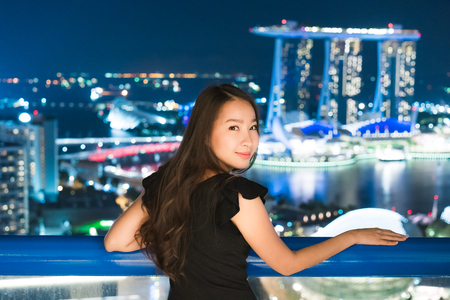 Beautiful Asian women smile and happy with  city view at night