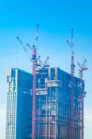 Crane construction site building exterior with blue sky
