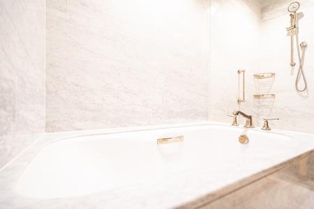 Beautiful luxury white bathtub and faucet decoration interior of bathroom