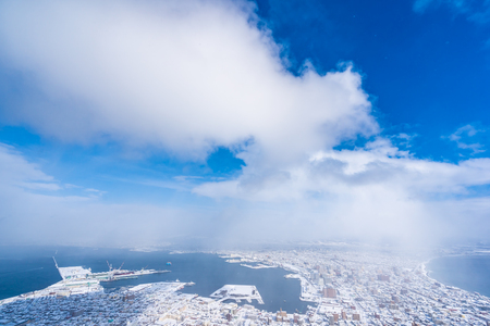 Beautiful landscape and cityscape from Mountain Hakodate for look around city skyline building and architecture with blue sky white cloud
