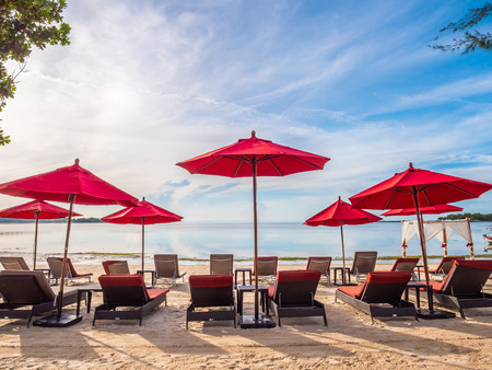 Umbrella and chair on the tropical beach sea and ocean for travel and vacation