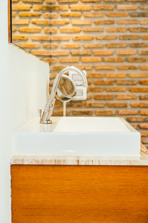 Faucet or water tap and white sink or washbasin decoration in bathroom interior