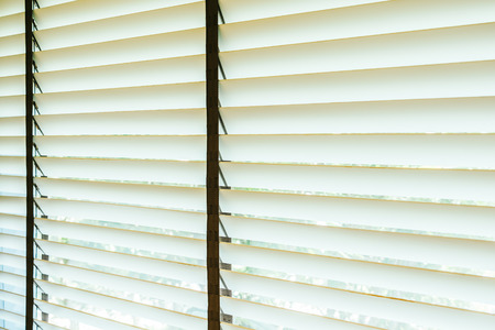Beautiful blinds window with sunlight decoration interior of room