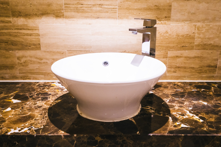 White sink and faucet decoration in bathroom interior