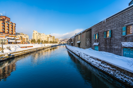 Beautiful landscape and cityscape of Otaru canal river in winter and snow season at Hokkaido Japan Stock Photo