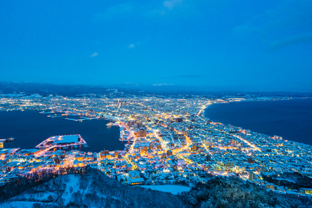 Beautiful landscape and cityscape from Mountain Hakodate for look around city skyline building and architecture at night Imagens