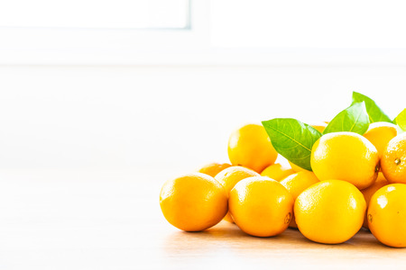 Fresh oranges fruit on wood table - Healthy food concept