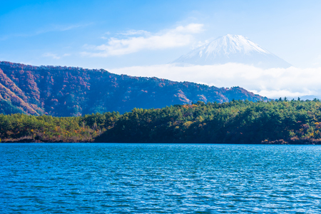 Beautiful landscape of mountain fuji with maple leaf tree around lake in autumn season Japan