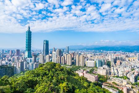 Beautiful landscape and cityscape of taipei 101 building and architecture in the city skyline with bluesky and white cloud at Taiwan Фото со стока