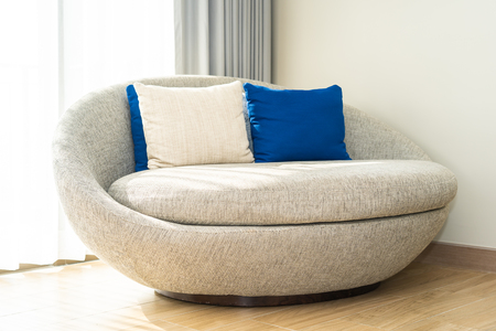 Comfortable pillow on sofa chair decoration in living area interior