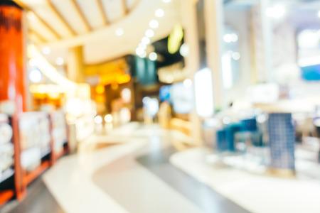 Desenfoque abstracto y centro comercial desenfocado del interior de la tienda por departamentos para el fondo