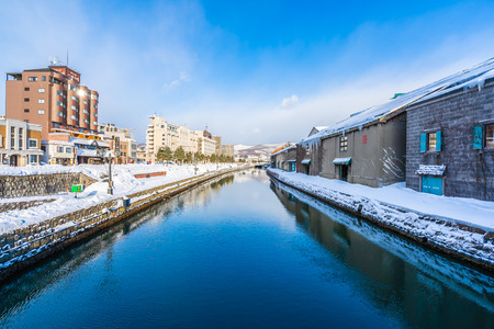 Beautiful landscape and cityscape of Otaru canal river in winter and snow season at Hokkaido Japan �ditoriale