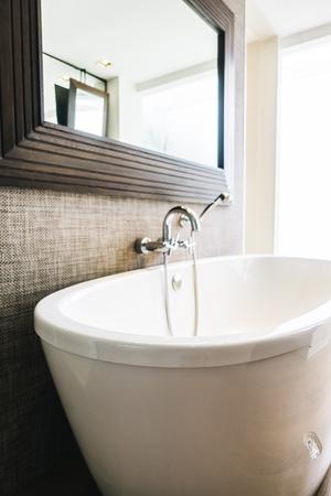 Beautiful luxury white bathtub decoration in bathroom interior