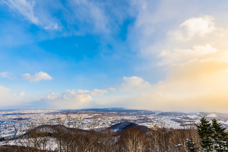 Beautiful landscape with mountain around tree in snow winter season at sunset time in Sapporo Hokkaido Japan Imagens