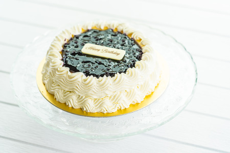 Sweet dessert with Blueberry cheese cake with happy birthday sign on top Imagens
