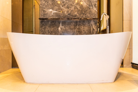 Beautiful luxury white bathtub decoration in bathroom interior for relax and spa