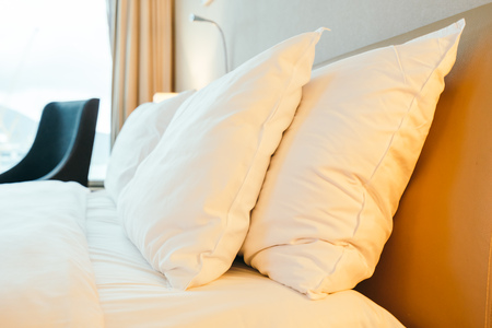 White pillow on bed decoration in hotel bedroom interior Imagens