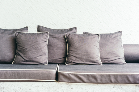 Comfortable pillow on sofa with outdoor patio