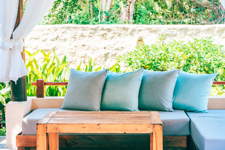Pillow on sofa chair decoration outdoor patio with garden view for relax and leisure Stock fotó