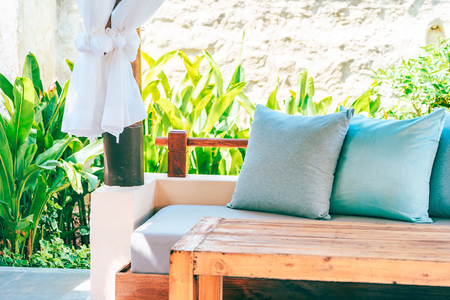Pillow on sofa chair decoration outdoor patio with garden view for relax and leisure Reklamní fotografie