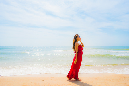 Portrait beautiful young asian woman smile with happy and walk on the beach and sea for leisure holiday vacation concept 스톡 콘텐츠