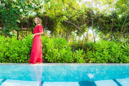 Portrait beautiful young asian woman relax leisure in swimming pool at hotel and resort for holiday vacation concept 스톡 콘텐츠