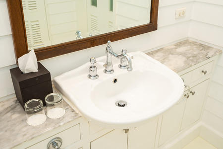 White sink and water tap faucet decoration interior of bathroom