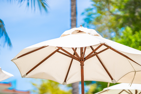 Umbrella and chair on the tropical beach and sea ocean for leisure travel and vacation cept Standard-Bild - 122092119