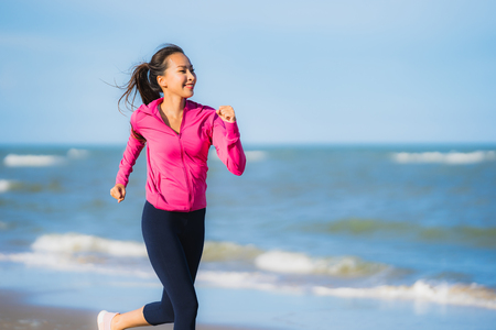 Portrait beautiful young asian woman running or exercise on the tropica nature landscape of beach sea ocean for healthy concept Stok Fotoğraf