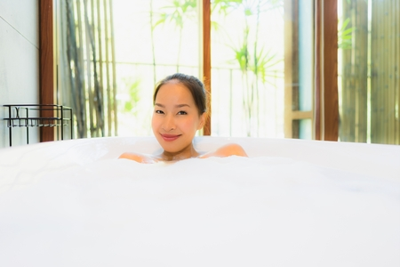 Portrait beautiful young asian woman in the bathtub for take a bath leisure and relax