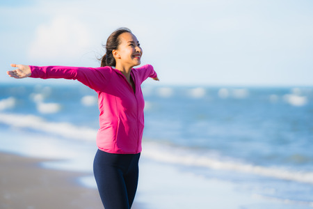 Portrait beautiful young asian woman running or exercise on the tropica nature landscape of beach sea ocean for healthy concept Stockfoto