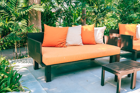 Pillow on sofa furniture decoration outdoor patio in the garden for leisure and relax Stok Fotoğraf - 122991436