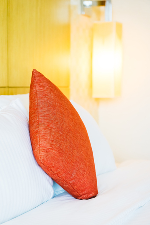 White comfortable pillow on bed decoration in hotel bed room interior 写真素材
