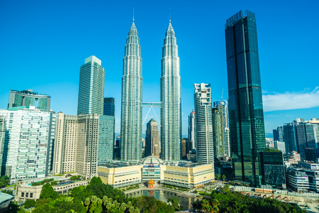 Beautiful architecture building exterior city in kuala lumpur skyline with white cloud and blue sky