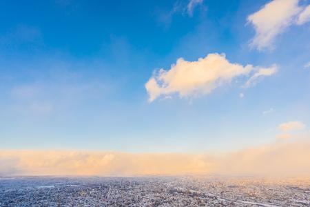 Beautiful landscape with moiwa mountain around tree and city in snow winter season at sunset time in Sapporo Hokkaido Japan 版權商用圖片