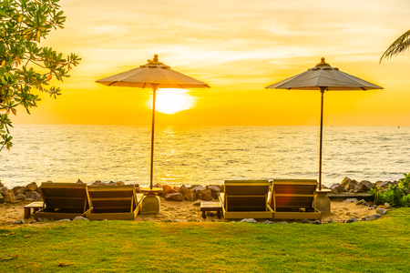Beautiful Landscape of sea ocean on sky with umbrella and chair around there at sunset or sunrise time for leisure vacation travel concept Stok Fotoğraf