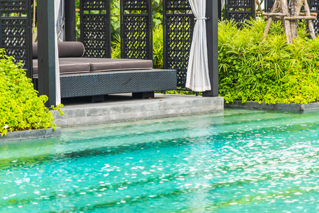 Beautiful outdoor swimming pool in hotel and resort with chair and deck for leisure vacation and travel