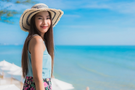 Portrait beautiful young asian woman happy smile relax around beach ocean and sea for leisure travel and vacation