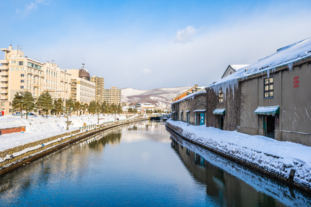 Beautiful landscape and cityscape of Otaru canal river in winter and snow season at Hokkaido Japan Editorial