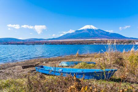 Beautiful landscape of mountain fuji with boat around yamanakako lake Japan