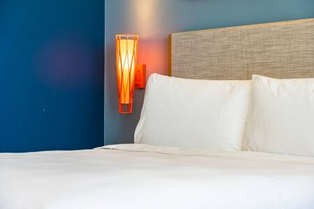 Beautiful comfortable white pillow and blanket on bed decoration in hotel bedroom Stok Fotoğraf
