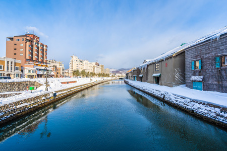 Beautiful landscape and cityscape of Otaru canal river in winter and snow season at Hokkaido Japan 報道画像